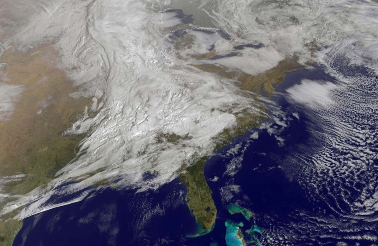 This March 5, 2013 NASA GOES handout image shows a satellite view of an enormous winter storm system running across the U.S. from Canada all the way down to the Florida panhandle. Two powerful winter storms blanketed huge swaths of the central United States Monday and threatened to bury much of the northern portion of the country in the coming days. (NASA HO via AFP/Getty Images)