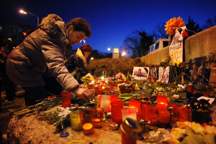 A woman lights a candle during a vigil on March 5, 2013 outside the city hall of Varna, on the site where a man who became a symbol of the three-week wave of protests against corruption, set himself on fire. Plamen Goranov, a 36-year-old amateur photographer and rock climber, died on March 3 after setting himself ablaze on February 20 in the Black Sea city of Varna. Goranov's self-immolation prompted Varna protestors to adopt his cause and turn their initial anger over high electricity bills against the long-time mayor, whom they accused of corruption and favouritism towards a local business group. (Nikolay Doychinov/AFP/Getty Images)