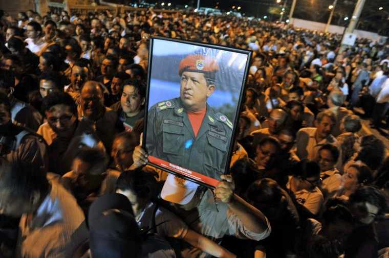 Nicaraguan supporter of President Hugo Chavez holds a picture of him in the ceremony in his honor the day of his death at the Revolution Square in Managua, on March 5, 2013. (Hector Retamal/AFP/Getty Images)