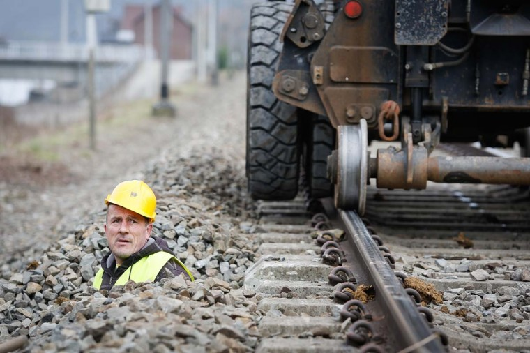 A man works checks what will be the first ETCS (European Train Control System) line, on March 6, 2013 in Profondeville, Wallonia. The modernization of the line, between Jambes and Dinant (L154), will enable the system to automatically stop a train that neglects a red light or exceeds the maximum speed limit. (Bruno Fahy/AFP/Getty Images)