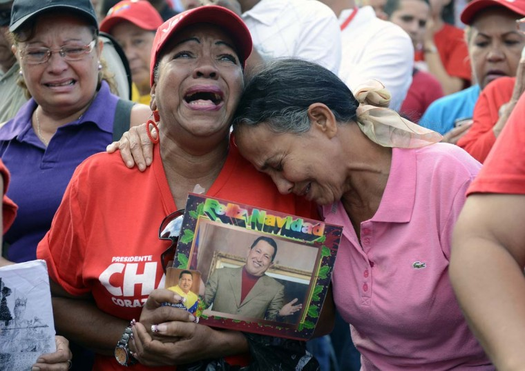 Supporters of the late Venezuelan President Hugo Chavez cry in front of the Military Hospital --where he had been hospitalized-- a day after his death in March 6, 2013, in Caracas. Venezuela was plunged into uncertainty Wednesday after the death of President Hugo Chavez, who dominated the oil-rich country for 14 years and came to embody a resurgent Latin American left. (Leo Ramirez/AFP/Getty Images)
