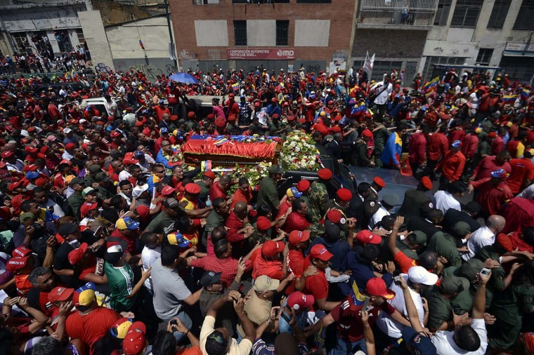 The hearse carrying the coffin of Venezuelan President Hugo Chavez makes its way to the Militar Academy amid thousands of supporters, on March 6, 2013, in Caracas. Venezuela was plunged into uncertainty Wednesday after the death on the eve of President Hugo Chavez, who dominated the oil-rich country for 14 years and came to embody a resurgent Latin American left. (Juan Bareto/AFP/Getty Images)