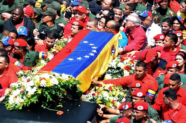 Supporters accompany the hearse carrying the coffin of Venezuelan President Hugo Chavez while leaving the Military Hospital to the Military Academy, on March 6, 2013, in Caracas. Venezuela was plunged into uncertainty Wednesday after the death on the eve of President Hugo Chavez, who dominated the oil-rich country for 14 years and came to embody a resurgent Latin American left. (Luis Camacho/AFP/Getty Images)