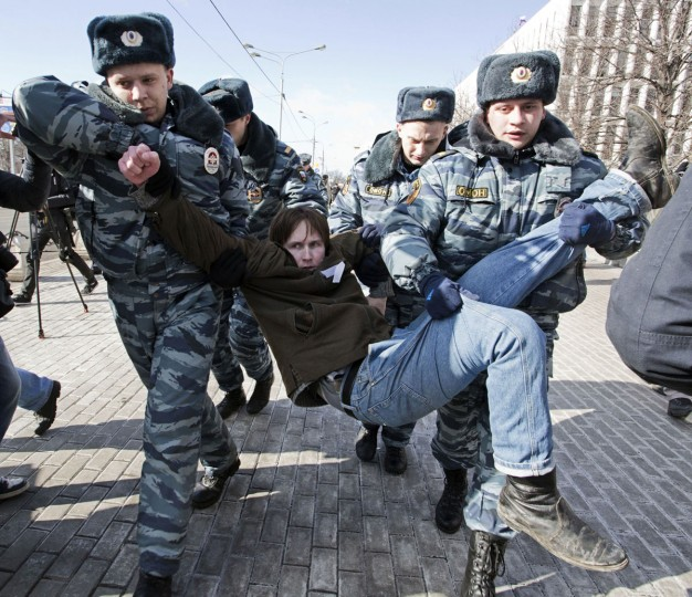 "Policemen detain an opposition supporter taking part in a picketing calling for the release of two jailed members of the Pussy Riot protest punk band in central Moscow on March 8, 2013. Nadezhda Tolokonnikova, a philosophy student, was sent to prison camp in October 2012 along with bandmate Maria Alyokhina, after being convicted of hooliganism motivated by religious hatred for singing a ""punk prayer"" in a Moscow cathedral protesting President Vladimir Putin's close links with the Russian Orthodox Church. (Evgeny Feldman/AFP/Getty Images)"