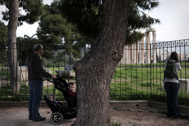 Tourists look at a temple of olympian Zeus through a closed gate on March 8, 2013 in Athens as archaeological sites and museums in Greece are closed due to a 24-hour strike by Ministry of Culture employees. Archaeological sites and museums across Greece have shut down for 24 hours by Culture Ministry employees, protesting planned reforms. (Louisa Gouliamaki/AFP/Getty Images)
