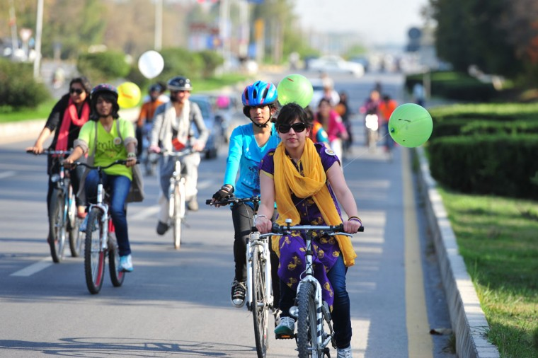 Pakistani women ride their bikes towards the city's landmark Faisal Mosque to mark International Women's day in Islamabad on March 8, 2013. A group of determined women took to bikes riding through the Pakistani capital to highlight their rights and love of exercise in a culture that often treats them as second-class citizens. (Farooq Naeem/AFP/Getty Images)