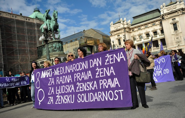 "Serbian women hold a banner during a rally in central Belgrade to mark International Women's Day, on March 8, 2013. Text on the banner reads ""March 8, International Women's Day, for women's labor rights, for women's human rights, for women's solidarity."" (Andrej Isakovic/AFP/Getty Images)"