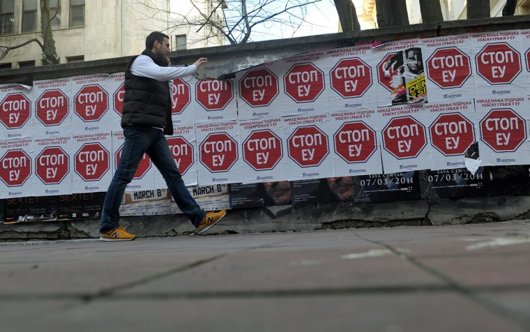 "A pedestrian walks past banners, reading ""Stop to EU"" signed by the nationalist Serbian Democratic Party, in central Belgrade on March 8, 2013. Serbia is aware it has no authority over Kosovo, but Serbia will accept no deal with Kosovo unless the Serb community there is given executive powers, Prime Minister Ivica Dacic said Thursday. (Andrej Isakovic/AFP/Getty Images)"