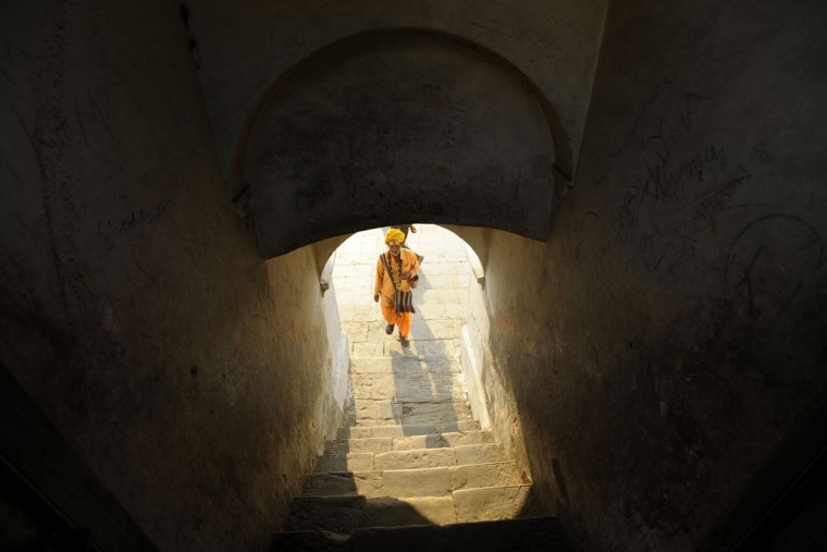 A Sadhu (Hindu holy man) walks near the Pashupatinath Temple ahead of the Hindu festival Maha Shivaratri in Kathmandu on March 8, 2013. Hindus mark the Maha Shivratri festival by offering special prayers and fasting. (Prakash Mathema/AFP/Getty Images)