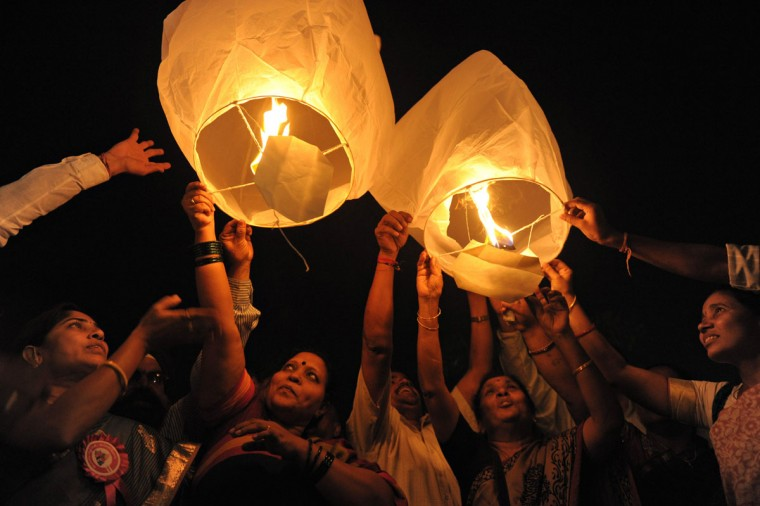All India Peace and Solidarity Organisation (AIPSO) members launch sky lanterns during International Women's Day in Hyderabad on March 8, 2013.(Noah Seelam/AFP/Getty Images)