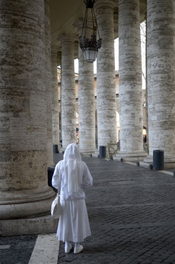 A nun walks along the colonnade early on March 12, 2013 at the Vatican. (Johannes Eisele/AFP/Getty Images)
