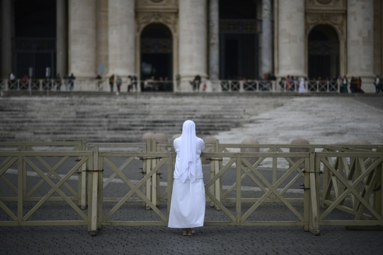 A nun prays in front of St. Peter's basilica early on March 12, 2013 at the Vatican. (Johannes Eisele/AFP/Getty Images)
