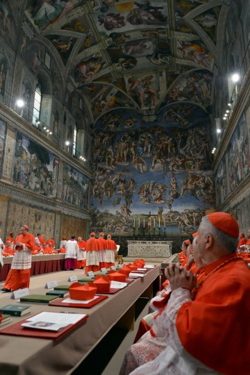 Cardinals queue in the Sistine Chapel to swear on the Bible to never reveal the secrets of their deliberations before the start of the conclave at the Vatican on March 12, 2013. (Osservatore Romano handout/AFP/Getty Images)