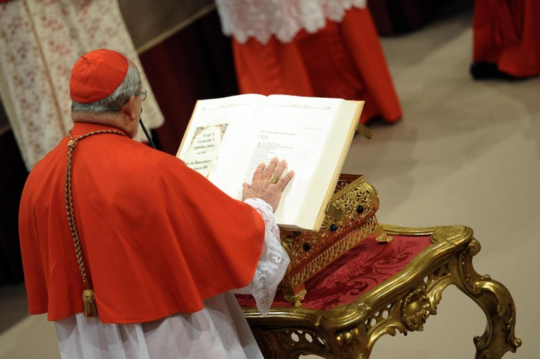 A cardinal swears on the bible in the Sistine Chapel before the start of the conclave at the Vatican on March 12, 2013. (Osservatore Romano/AFP/Getty Images)