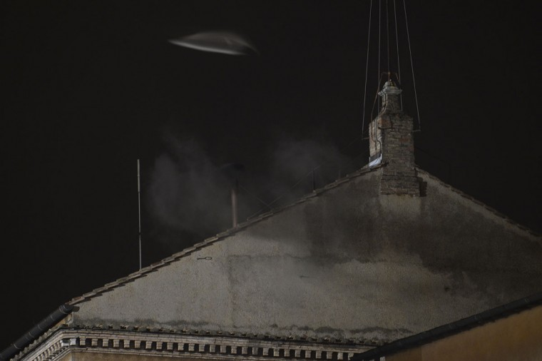 Black smoke rises from the chimney on the roof of the Sistine Chapel, meaning that cardinals failed to elect a new pope in the first ballot of their secret conclave on March 12, 2013 at the Vatican. (Andreas Solaro/AFP/Getty Images)