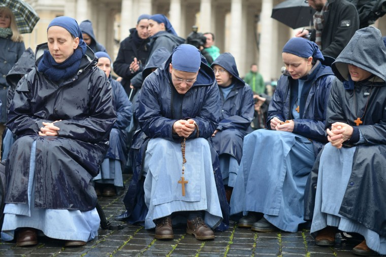 Nuns pray at St. Peter's Square on the second day of the conclave on March 13, 2013 at the Vatican. Cardinals prepared for a second day of conclave behind the Vatican's walls to elect a pope today, with all eyes on a chimney that will signal when there is a new leader for the world's 1.2 billion Catholics. (Gabriel Bouys/AFP/Getty Images)