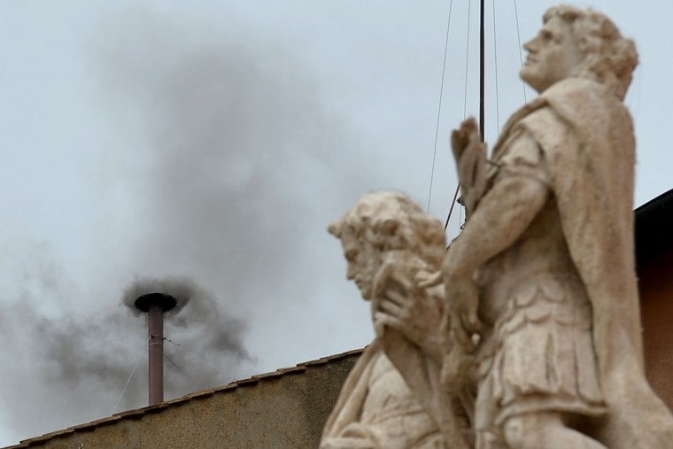 Black smoke rises from the chimney on the roof of the Sistine Chapel, signifying that cardinals failed to elect a new pope in the second ballot of their secret conclave on March 13, 2013 at the Vatican. The 115 cardinals are isolated in the Sistine Chapel in the process of finding a successor to Benedict XVI. (Vincenzo Pinto/AFP/Getty Images)