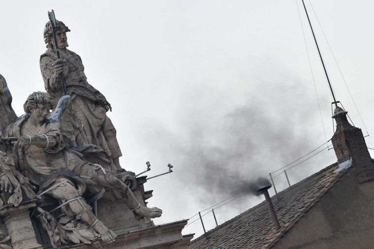 Black smoke rises from the chimney on the roof of the Sistine Chapel, signifying that cardinals failed to elect a new pope in the second ballot of their secret conclave on March 13, 2013 at the Vatican. The 115 cardinals are isolated in the Sistine Chapel in the process of finding a successor to Benedict XVI. (Tiziana Fabi/AFP/Getty Images)