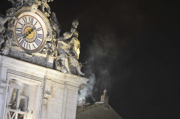 White smoke rises from the chimney on the roof of the Sistine Chapel meaning that cardinals elected a new pope in their ballot of their secret conclave on March 13, 2013 at the Vatican. (Filippo Monteforte/AFP/Getty Images)