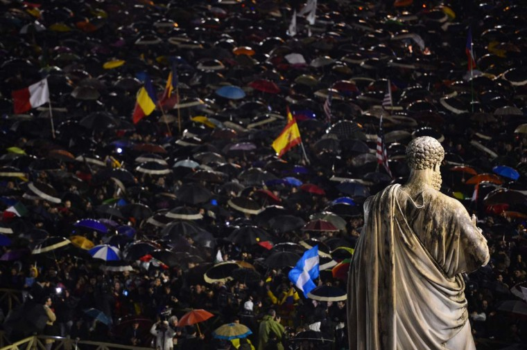 Faithfuls react in St Peter's Square after white smoke billowed from the chimney of the Sistine Chapel announcing that Catholic Church cardinals had elected a new pope during a conclave on March 13, 2013 at the Vatican. (Giuseppe Cacace/AFP/Getty Images)