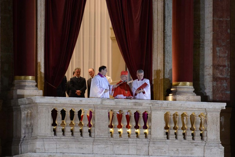 French proto-deacon cardinal Jean-Louis Tauran (C) announces the name of the new Pope, Argentinian cardinal Jorge Mario Bergoglio on March 13, 2013 from the balcony of St Peter's basilica at the Vatican. (Filippo Monteforte/AFP/Getty Images)