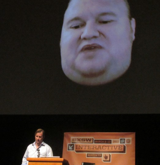Megaupload founder Kim Dotcom appears on March 11 2013 via Skype video link from New Zealand, with journalist Charles Graeber on the stage below him, during the South by Southwest festival. Dotcom explained his fight against extradition to the United States, which alleges that Megaupload cost the US movie industry millions of dollars in copyright infringement before a police raid on his home outside Auckland shut it down. (Robert MacPherson/AFP/Getty Images)