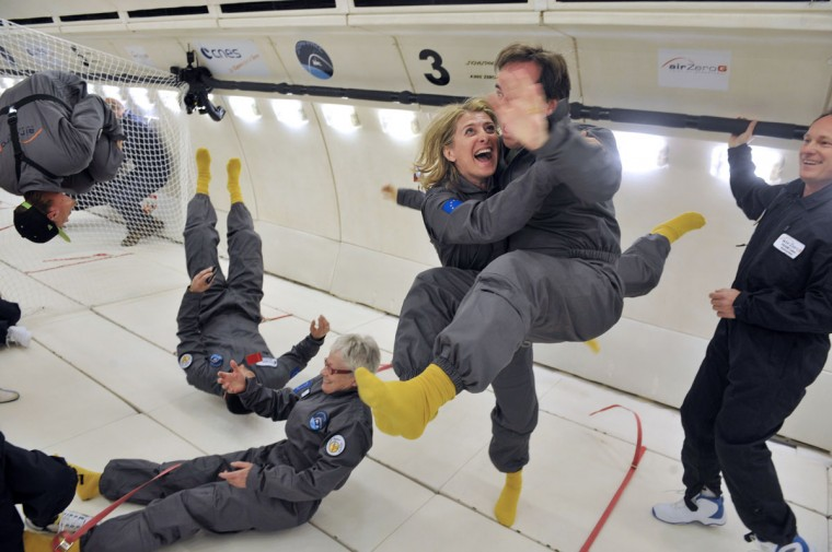 Civilian passengers of the Airbus A330 Zero-G, who are not astronauts nor scientists, enjoy the weightlessness during the first zero gravity flight for paying passengers in Europe. All boarding cards, costing 6,000 euros, were sold for the years 2013 and 2014. Zero gravity flights for paying passengers have already taken place in the United States and Russia. The zero-gravity of space is simulated by flying a series of parabolic flight maneuvers that counter the forces of gravity and allow astronauts and cosmonauts to learn how to accomplish tasks with no gravity. (Mehdi Fedouach/AFP/Getty Images)