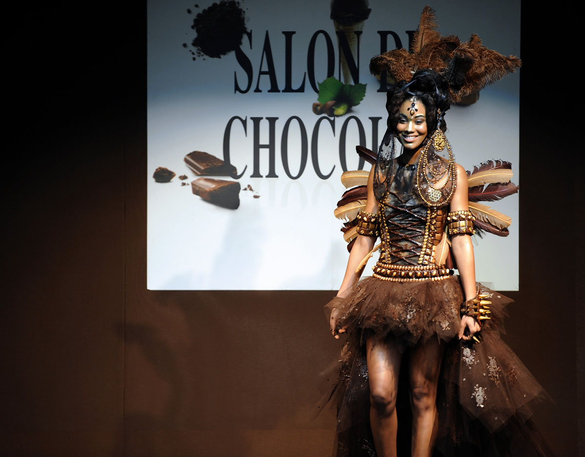 A model presents a dress made from chocolate