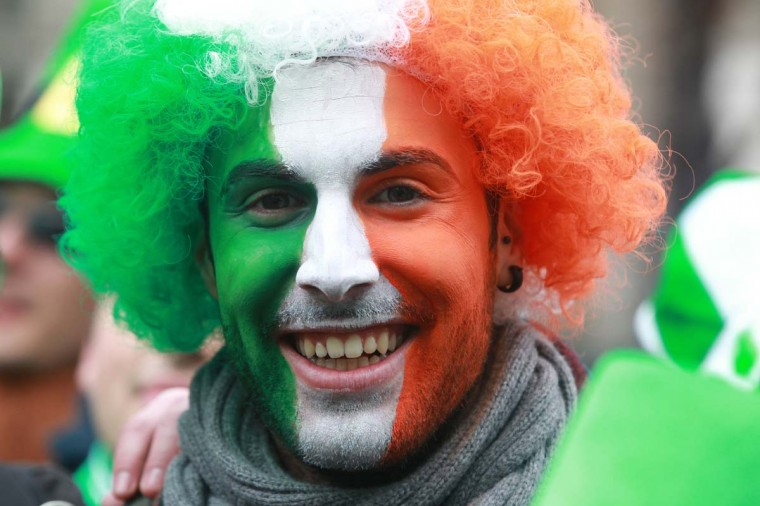 A reveller with his face painted the colours of the Irish flag attends St Patrick's Day festivities in Dublin on March 17, 2013. More than 100 parades are being held across Ireland to mark St Patrick's Day, the feast day of the patron saint of Ireland, with up to 650,000 spectators expected to attend the parade in Dublin. Ireland has high hopes that the festivities will bring a much-needed boost to the economy. (Peter Muhly/AFP/Getty Images)