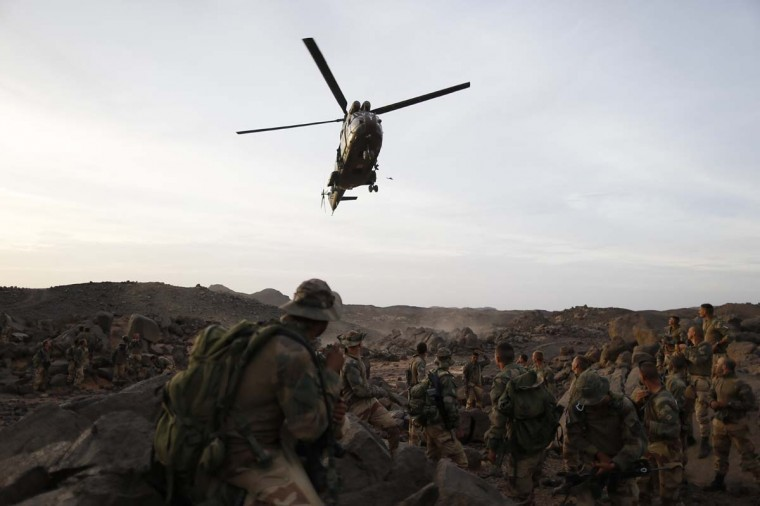 A Puma helicopter lands near legionnaires of the French army's 2nd Foreign Parachute Regiment in the Adrar of the Ifoghas mountains on March 17, 2013. A French corporal was killed tracking down jihadist fighters in their northern Mali mountain bastions, bringing to five the number of French deaths since Paris launched a military offensive in the country two months ago. Defense Minister Jean-Yves Le Drian said on March 17, 2013 the 24-year-old soldier was killed and three of his comrades wounded when their vehicle was struck by a roadside bomb blast in the Ifoghas mountains, without saying when it happened. (Kenzo Tribouillard/AFP/Getty Images)