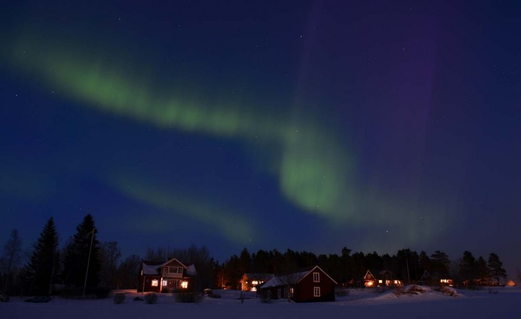 The Aurora Borealis bright up the sky at twilight on March 17, 2013 between the towns of Are and Ostersund, Sweden. (Jonathan Nackstrand/AFP/Getty Images)