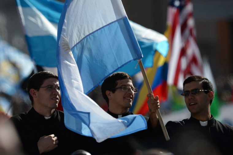 Priests wave an Argentinian flag during the inauguration mass of Pope Francis at St Peter's Square on March 19, 2013 at the Vatican. (Filippo Monteforte/AFP/Getty Images)