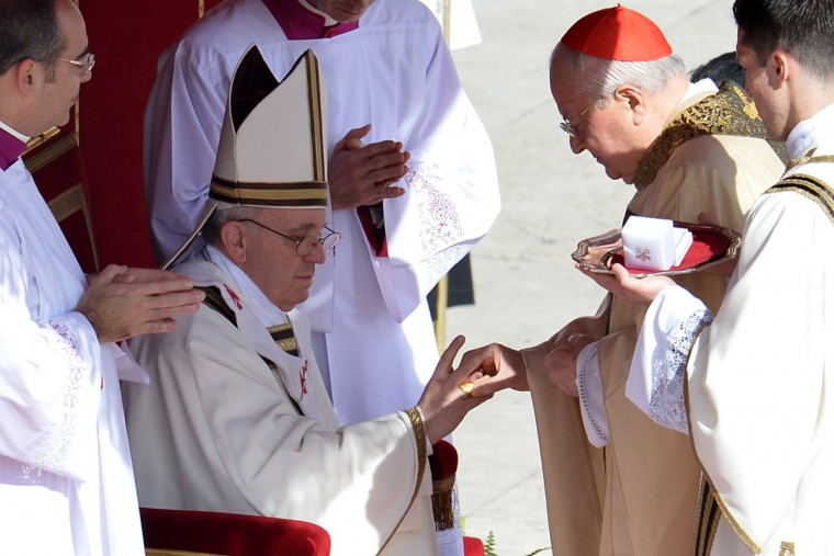 Italian cardinal Angelo Sodano, right, puts the Fisherman's Ring, made of gold-plated silver, on a finger of Pope Francis during the pope's inauguration mass on March 19, 2013 at the Vatican. (Alberto Pizzoli/AFP/Getty Images)
