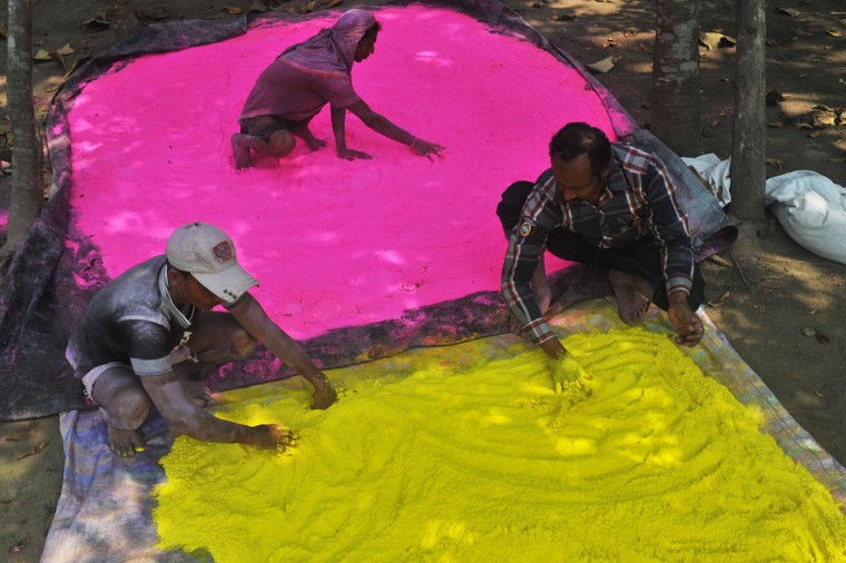 "Indian laborers prepare colored powder, known as ""gulal"", to be used during the forthcoming spring festival of Holi, on the outskirts of Siliguri on March 20, 2013. (Diptendu Dutta/AFP/Getty Images)"