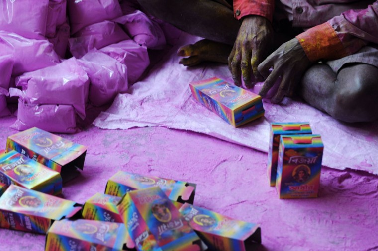 "An Indian laborer packs colored powder, known as ""gulal"", to be used during the forthcoming spring festival of Holi, on the outskirts of Siliguri on March 20, 2013. Holi, the popular Hindu spring festival colours observed in India at the end of the winter season on the last full moon of the lunar month, will be celebrated March 27 this year. (Diptendu Dutta/AFP/Getty Images)"