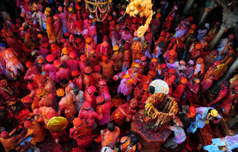Hindus throw colored powder at the Radha Rani temple during the Lathmar Holi festival in Barsana on March 21, 2013. Lathmar Holi is a local celebration, but it takes place well before the national Holi day on March 27. (Sanjay Kanojia/AFP/Getty Images)