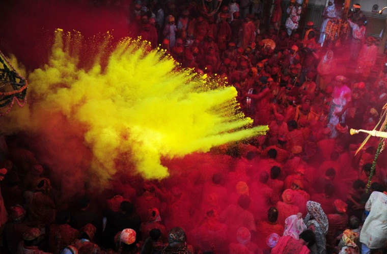 Hindus throw colored powder at the Radha Rani temple during the Lathmar Holi festival in Barsana on March 21, 2013. Lathmar Holi is a local celebration, but it takes place well before the national Holi day on March 27.(Sanjay Kanojia/AFP/Getty Images)