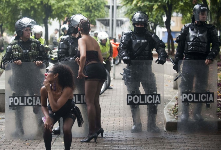 Students perform by riot police during a protest in Medellin, Antioquia department, Colombia on March 21, 2013, demanding a better and free education and an alternative university reform. (Raul ArboledaA/AFP/Getty Images)