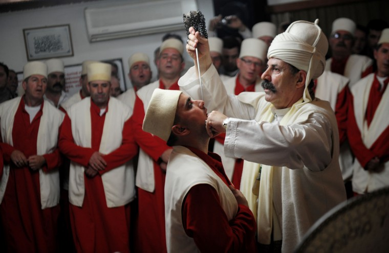 Kosovo dervishes, adepts of Sufism, a mystical form of Islam that preaches tolerance and a search for understanding, take part in a ceremony in the prayer room in the town of Gjakova on March 21, 2013. The Kosovo dervish community carries on centuries-old mystical practices, such as self-piercing with needles and knives as a way to earn salvation and find the path to God.(Armend Nimani/AFP/Getty Images)