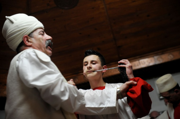 Kosovo dervishes, adepts of Sufism, a mystical form of Islam that preaches tolerance and a search for understanding, take part in a ceremony in the prayer room in the town of Gjakova on March 21, 2013. (Armend Nimani/AFP/Getty Images)