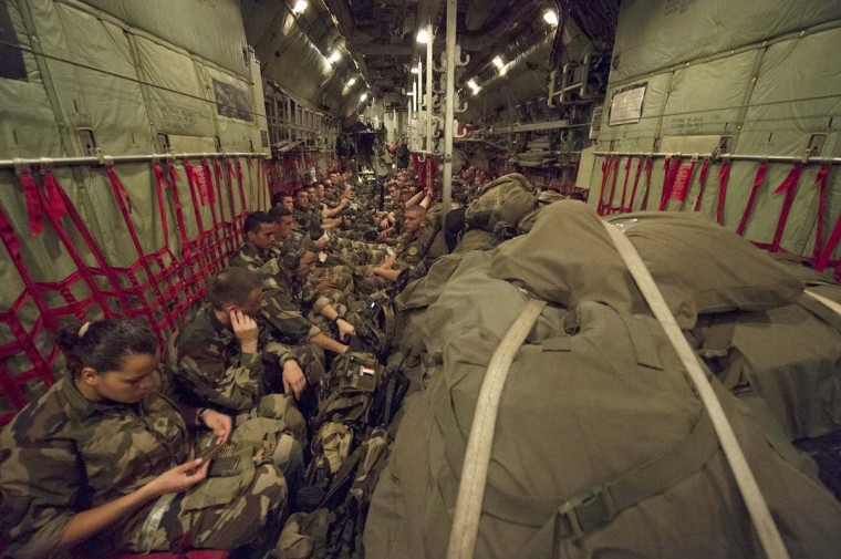 This handout picture taken on March 22, 2013 and released on March 24, 2013 shows French troops sitting in a plane as they arrive at Bangui's airport. France has sent 350 soldiers to the Central African Republic, whose capital Bangui has been taken by rebels, to ensure the security of French nationals and other foreigners, a senior official said Sunday. (Elise Foucaud/EMA-EDPAD via AFP/Getty Images)
