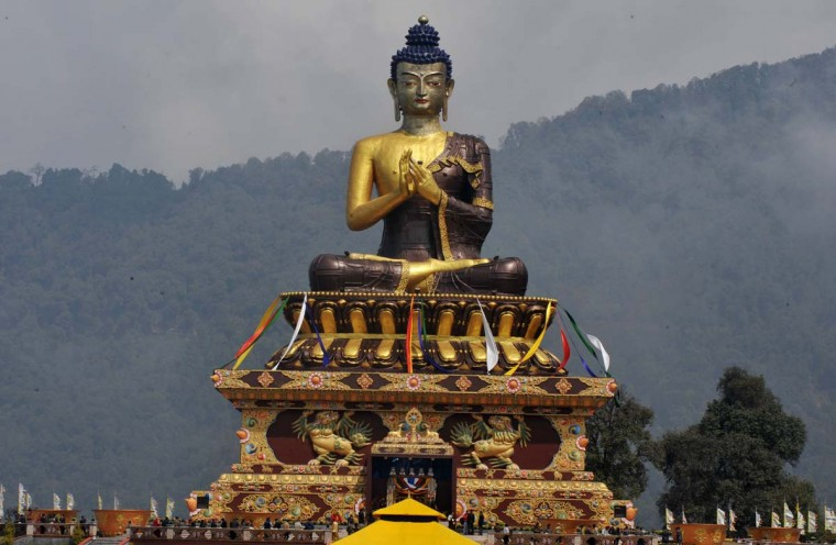 Buddhist monks and devotees gather for the inauguration of the 130 foot Lord Buddha statue by Tibetan spiritual leader, the Dalai Lama at Buddha Park in Rabong in South Sikkim on March 25, 2013. The Buddha park named 'Tathagatatsal' covers an area of 23 acres and was formally inaugurated by Tibetan spiritual leader Dalai Lama. (Diptendu Dutta/AFP/Getty Images)