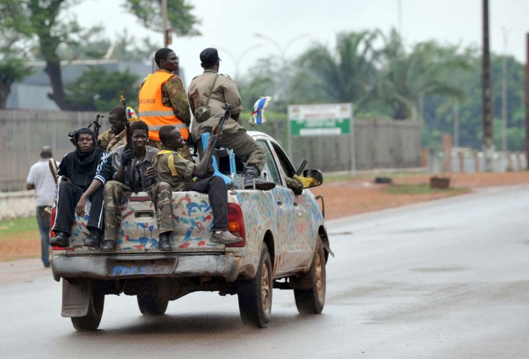 Seleka coalition rebels patrol on March 25, 2013 in Bangui. The UN Security Council will hold urgent talks on March 25 after a bloody coup in Central Africa sent ousted leader Francois Bozize fleeing across the border, and left 13 South African soldiers dead. Seleka coalition rebels seized the capital Bangui on March 24 after the collapse of a two-month-old peace deal with Bozize's regime. Bangui was on edge on March 25 as residents waited for a formal statement by rebel leader Michel Djotodia declaring himself president. (Sia Kambou/AFP/Getty Images)