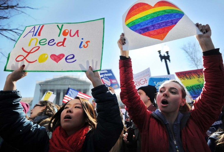 Same-sex marriage supporters shout slogans in front of the U.S. Supreme Court on March 26, 2013 in Washington, DC. (Jewel Samad/AFP/Getty Images)