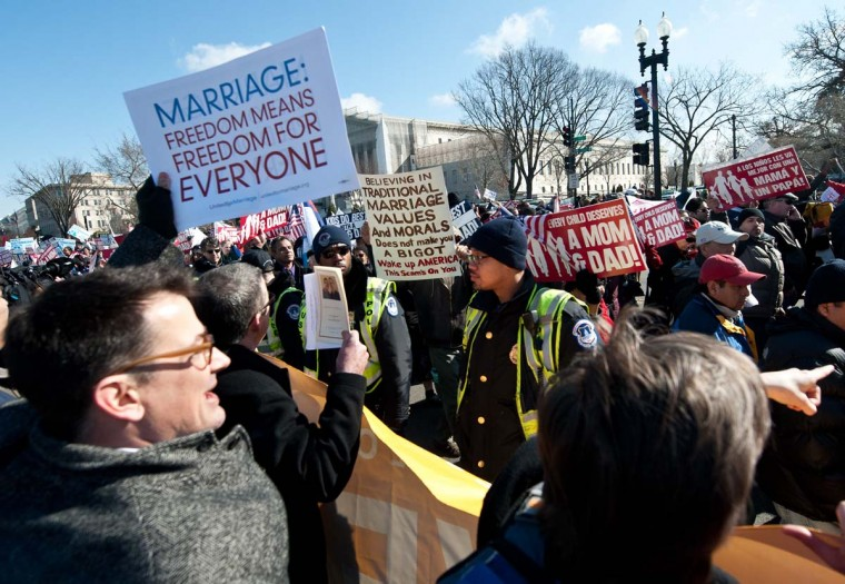 Opponents and supporters of same-sex marriage converge in front of the U.S. Supreme Court as the March for Marriage arrives at the court in Washington, DC on March 26, 2013. The court is hearing arguments on California's Proposition 8 ban on same-sex marriage. (Nicholas Kamm/AFP/Getty Images)