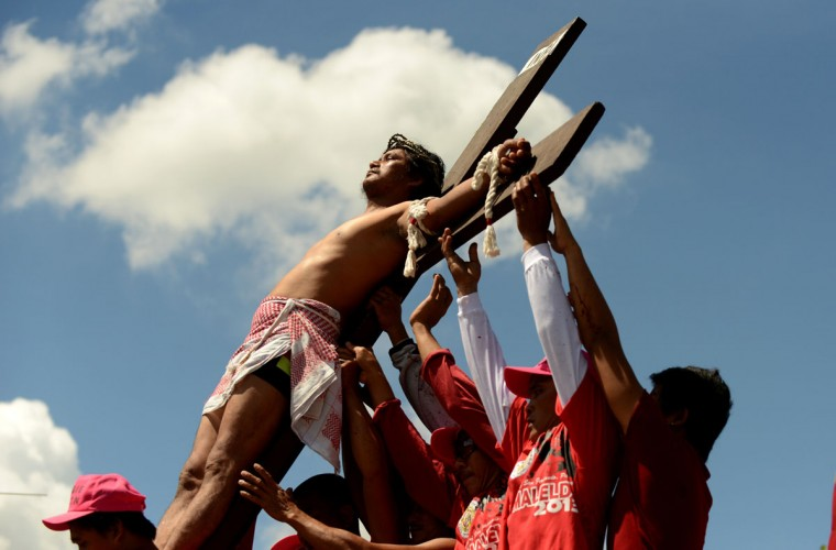 March 29, 2013: A penitent is nailed to the cross during the reenactment of crucifixion on Good Friday in the village of San Juan, San Fernando City, north of Manila. (Noel Celis/AFP/Getty Images)