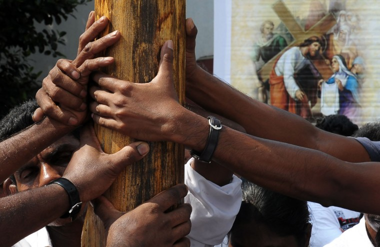 March 29, 2013: Sri Lankan Christian devotees take part in the annual Way of the Cross ritual, which symbolises the final journey of Jesus Christ before he was crucified, during a Good Friday service in Colombo. Christians account for around six percent of Sri Lanka's 20 million population. (Lakruwan Wanniarachchi/AFP/Getty Images)
