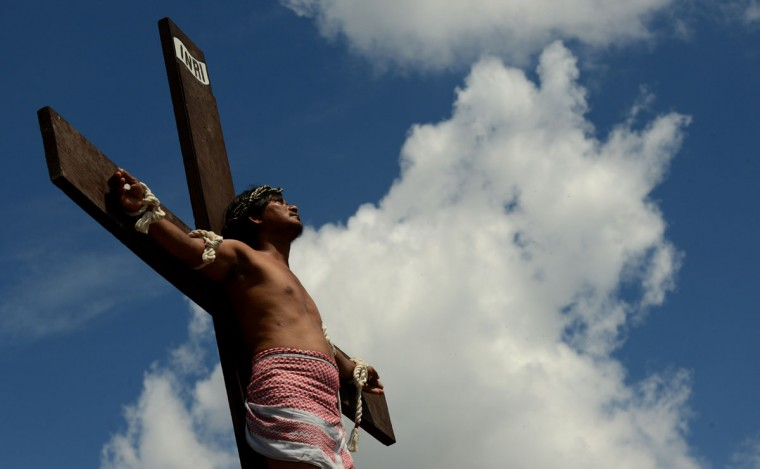 March 29, 2013: A penitent is nailed to the cross during the reenactment of the crucifixion on Good Friday in the village of San Juan, San Fernando City, north of Manila. (Noel Celis/AFP/Getty Images)