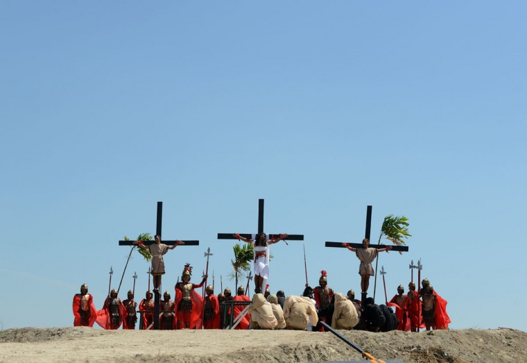 March 29, 2013: Philippine Christian devotee Ruben Enaje (C), is nailed to a cross during a re-enactment of the crucifixion of Jesus Christ on Good Friday in San Fernando City, Pampanga province, north of Manila. (Noel Celis/AFP/Getty Images)