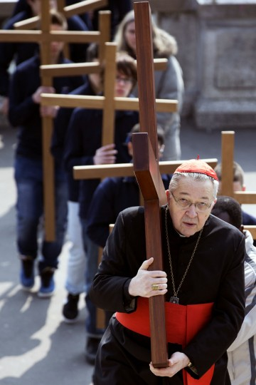 March 29, 2013: Paris' archbishop Andre Vingt-Trois carries a cross as he takes part in a Way of the Cross in Paris, in front of the Sacre-Coeur Basilica in Montmartre district, to celebrate Good Friday. (Joel Saget/AFP/Getty Images)